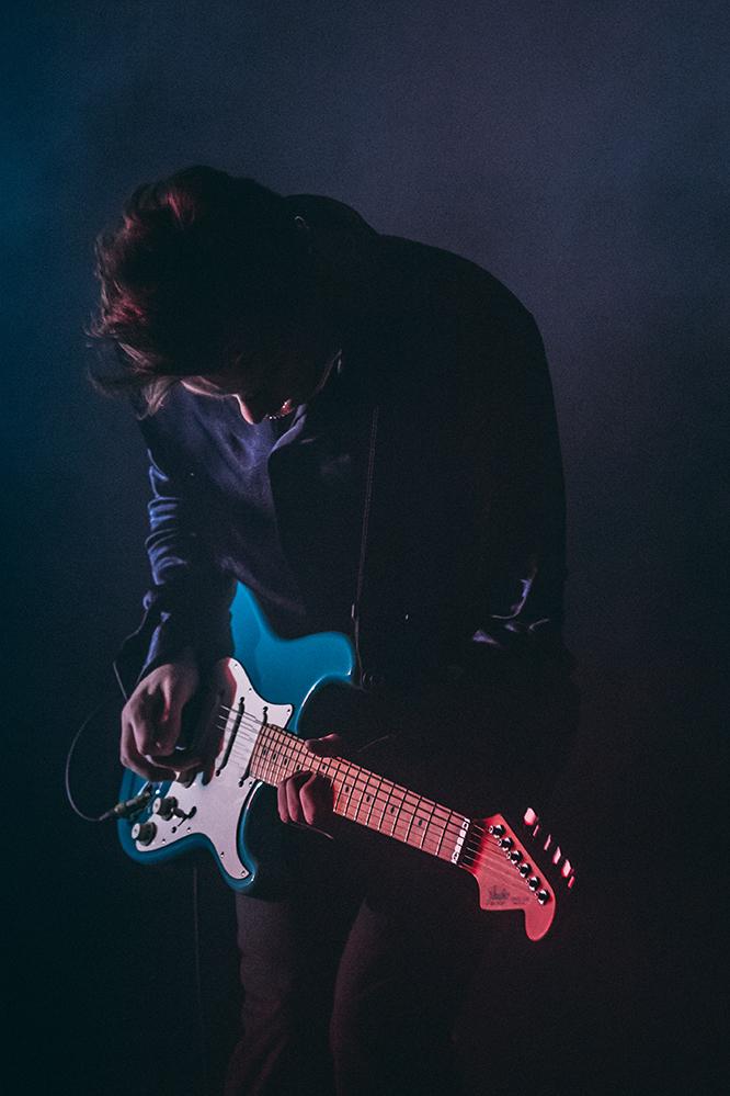 pale wave guitarist performing at Birmingham Arena