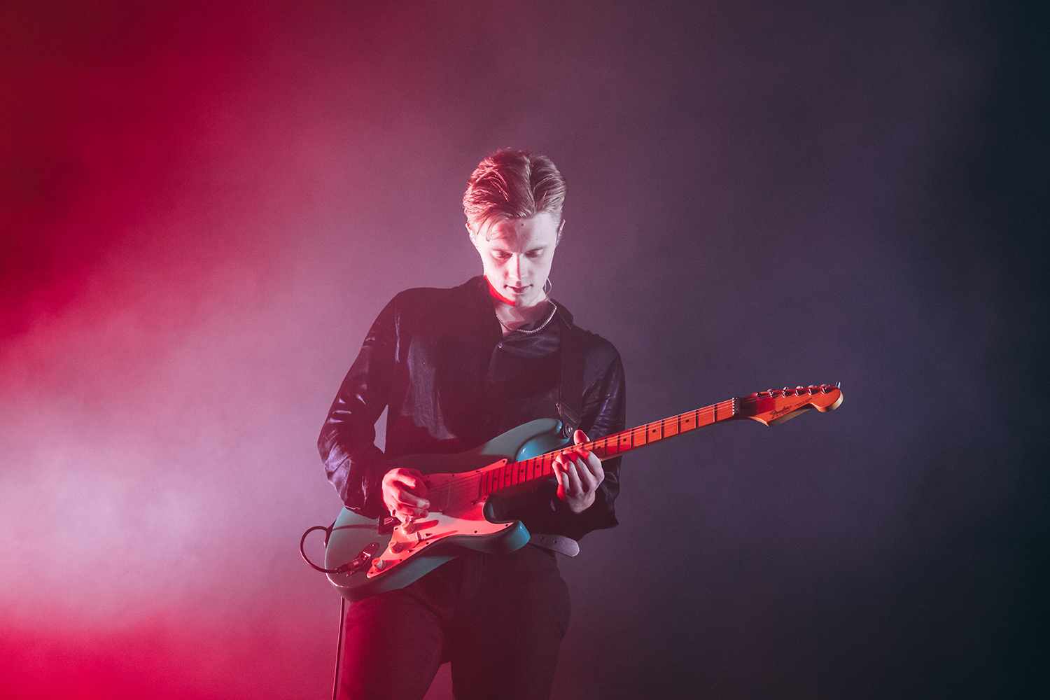 pale waves guitarist red and blue performing at Birmingham arena